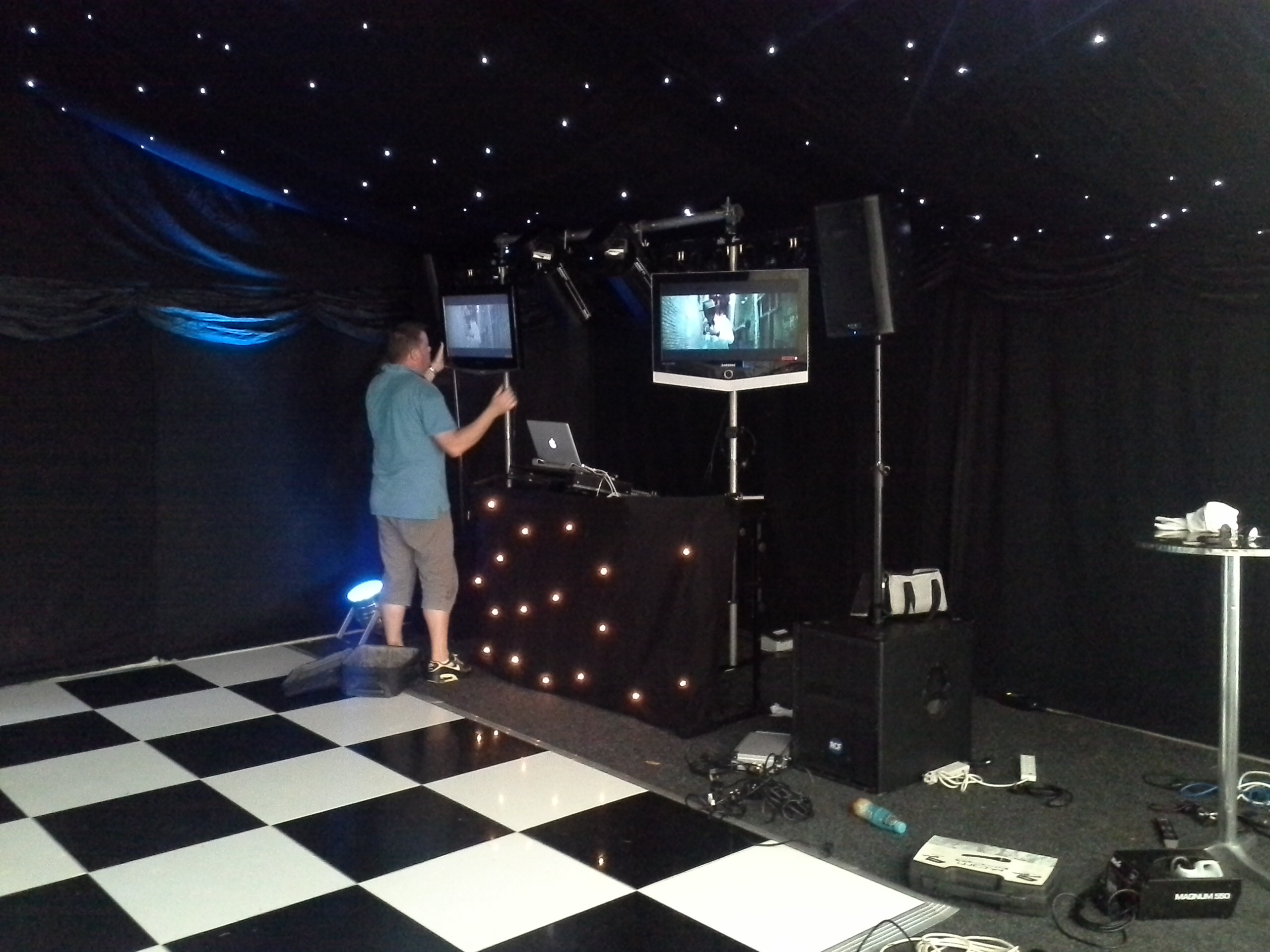 Our video DJ Simon - fixing up the screens ready for the party peeps to boogie on down, dancing and watching their fave tunes