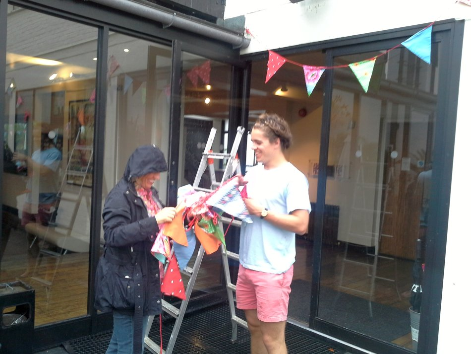 My lovely clients in the rain outside the worx hanging bunting